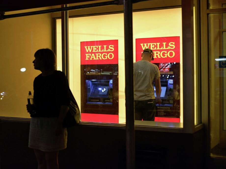 As of today, Wells Fargo will be the first major U.S. bank to offer a card-free option at all of its ATMs. The bank's customers will be able to use their smartphones to access any of the bank's 13,000 ATMs. Other major U.S. banks have rolled out card-free ATMs in limited locations. Photo: Patrick Sison /Associated Press / ' Patrick Sison