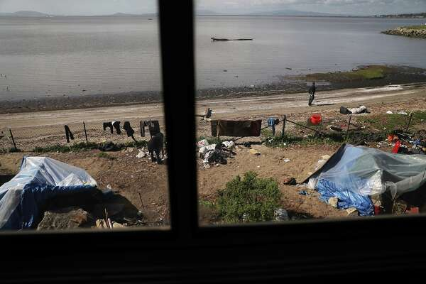 CROCKETT, CA - MARCH 25: A homeless encampment is seen as Amtrak's California Zephyr passes along San Pablo Bay as it comes close to the end of its daily 2,438-mile trip to Emeryville/San Francisco from Chicago that takes roughly 52 hours on March 25, 2017 in Crockett, United States.  President Trump has proposed a national budget that would terminate federal support for Amtrak's long distance train services, which would affect the California Zephyr and other long distance rail lines run by Amtrak.  (Photo by Joe Raedle/Getty Images)