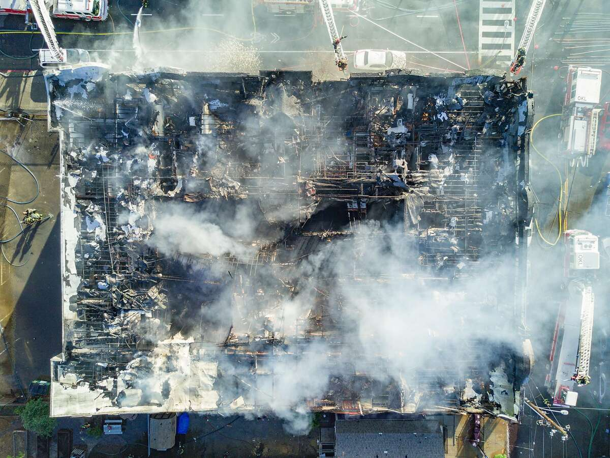 Firefighters work to put out a residential structure fire at the intersection of 26th Avenue and San Pablo in Oakland Calif. on Monday March 27, 2017.