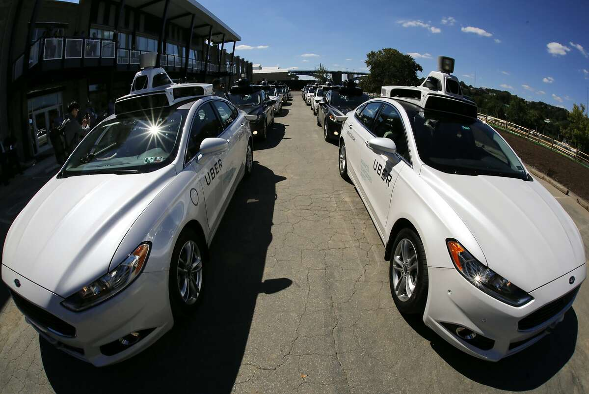 FILE - In this Monday, Sept. 12, 2016, photo, a group of self-driving Uber vehicles position themselves to take journalists on rides during a media preview at Uber's Advanced Technologies Center in Pittsburgh. On Monday, March 27, 2017, Uber said it is resuming its self-driving car program in Arizona and Pittsburgh after it was suspended following a crash over the weekend. The company had also grounded self-driving cars in San Francisco over the weekend but they resumed operating earlier on Monday. The company said that it paused the operations over the weekend to better understand what happened in Arizona, but feels confident in returning the cars to the road. (AP Photo/Gene J. Puskar, File)