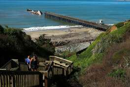 The SS Palo Alto, is seen just offshore broken apart at the end of the pier at Seacliff State Beach, in Aptos, Ca., on Mon. March 27, 2017 after being damaged by winter storms.