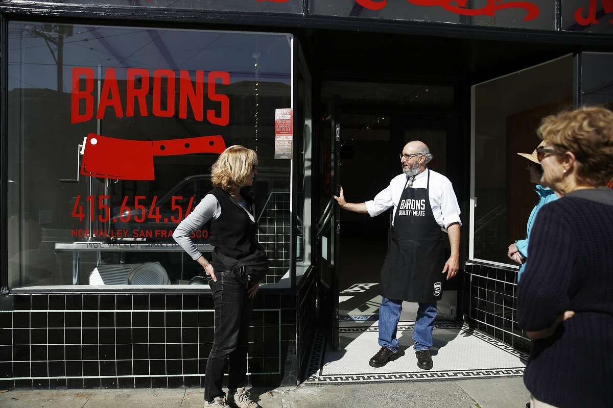 David Samiljan (second from left), owner Baron's Meats of Alameda, and Kay Harnich-Ladd (right) talk in front of Baron's Meats of Alameda on Church Street as Samijan worked at the store a few hours before it opened on Monday, March 27, 2017 in San Francisco, Calif.