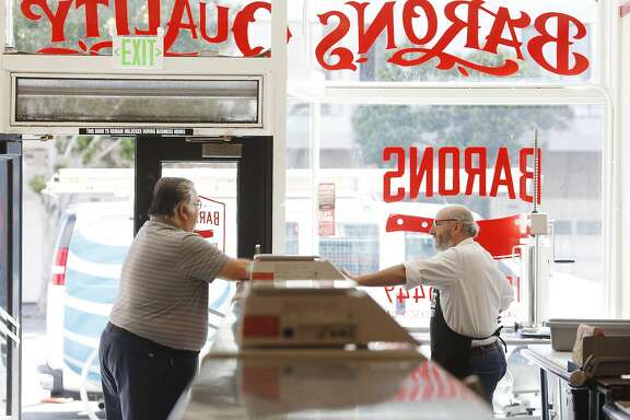 David Samiljan (right), owner Baron's Meats of Alameda, talks with Manfred Schaub (left) after Schaub noticed Baron's Meats of Alameda  at the location of where  Drewes Bros. Meats used to be at the store a few hours before it opened on  Monday, March 27, 2017 in San Francisco, Calif.  Schaub remembered Drewes Bros. Meats from his childhood.