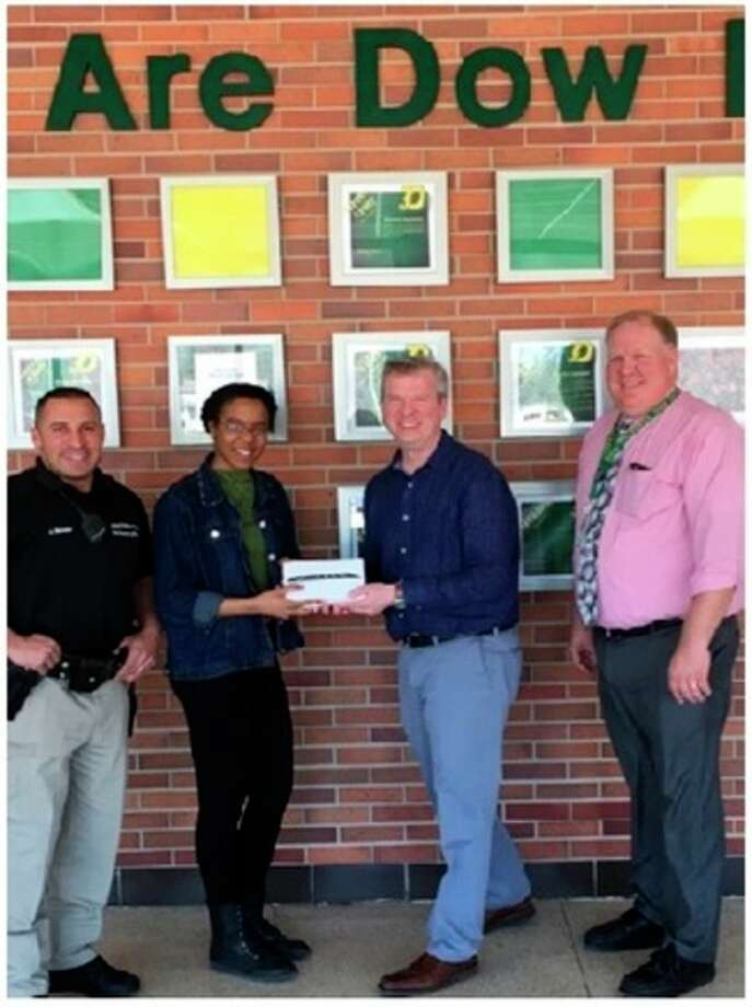 Project 111's H.H. Dow High School student Victoria Anaele, Mdiland Police School Resource Officer Jai Mahabir, Dr. Dale Davis of Davis & Davis Orthodontics, and Principal Steve Poole.
