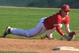 Plainview shortstop Carson Hauk dives to keep a ball from going into center field during a game against Hereford last week. Hauk scored three runs and drove in three Saturday to help the Bulldogs to a 14-1 win over the Herd. Plainview is 4-0 in District 3-5A.