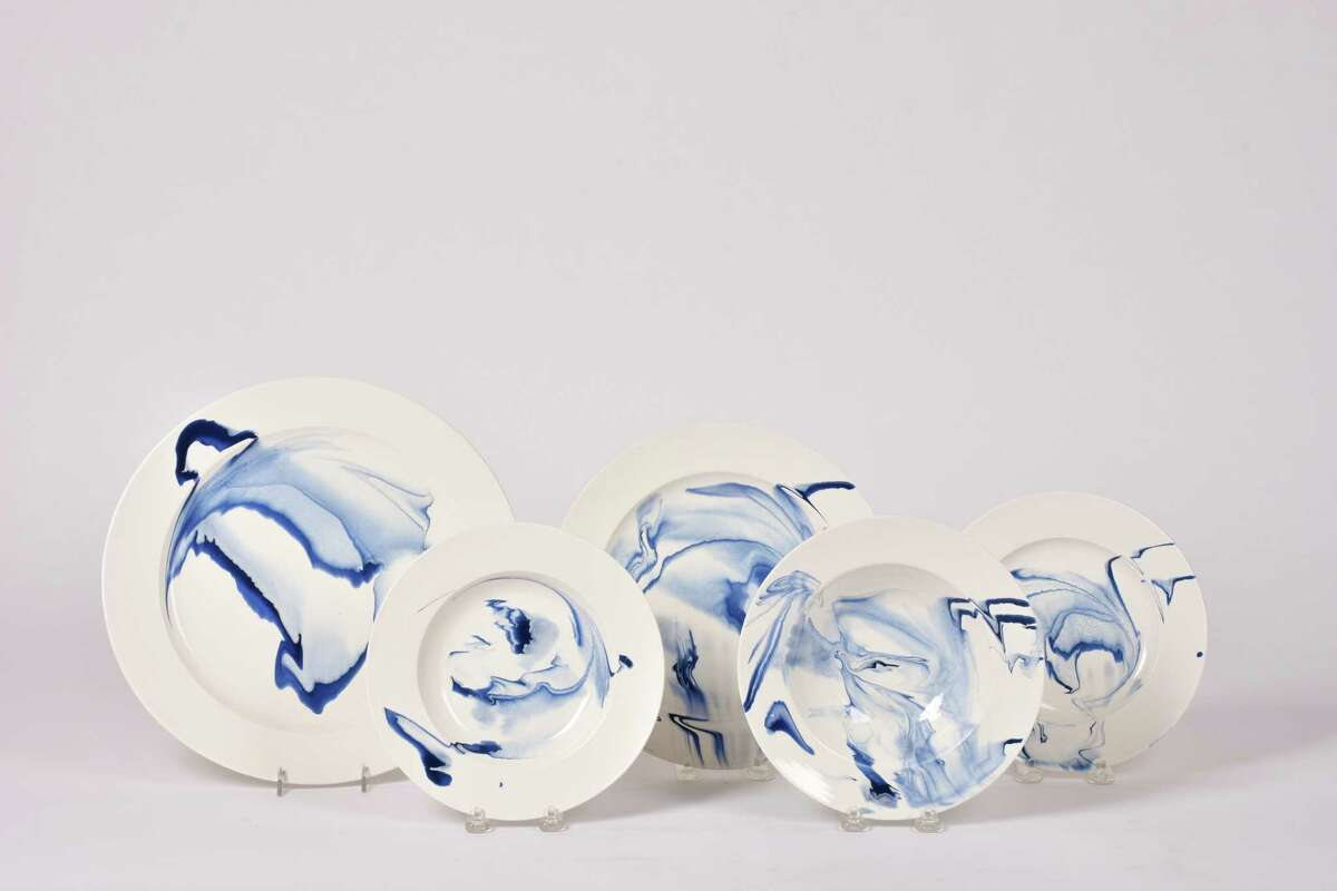 Spitzmiller's a new tableware collection includes plates, cups covered jars and garden stools. Prices range from $105 for smaller pieces to $2,500 for garden stools. These plates are shown in Delft blue.