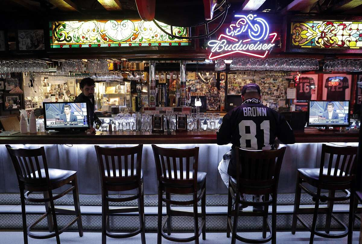 Justin Reina of Oakland sits alone at the bar at Ricky's Sports Theater and Grill following the news of the Raiders imminent departure in San Leandro, Calif., on Monday, March 27, 2017. The NFL announced that team owners had approved the Raiders' move to Las Vegas.