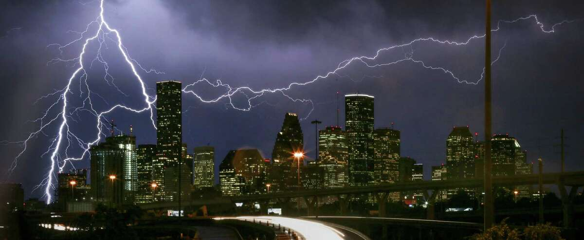 Lightning flashes over the Houston skyline in this 2016 photo. Despite the threats of nasty weather, Fourth of July events are scheduled to go on. Click through the gallery to see what's planned.