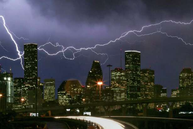 Lightning flashes over the Houston skyline in this 2016 photo. (Jon Shapley / Houston Chronicle )