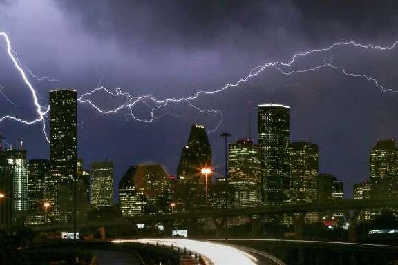 Lightning flashes over the Houston skyline in this 2016 photo. (Jon Shapley / Houston Chronicle )