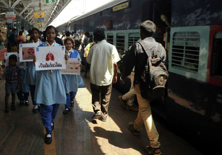 Indian schoolchildren hold placards as they take part in a tuberculosis awareness campaign at a railway station in Chennai on World Tuberculosis Day.  World Tuberculosis Day, which is observed on March 24, is designed to build public awareness about the global epidemic of tuberculosis and highlight efforts to eliminate the disease.(Photo: Arun Sankar / AFP/Getty Images)