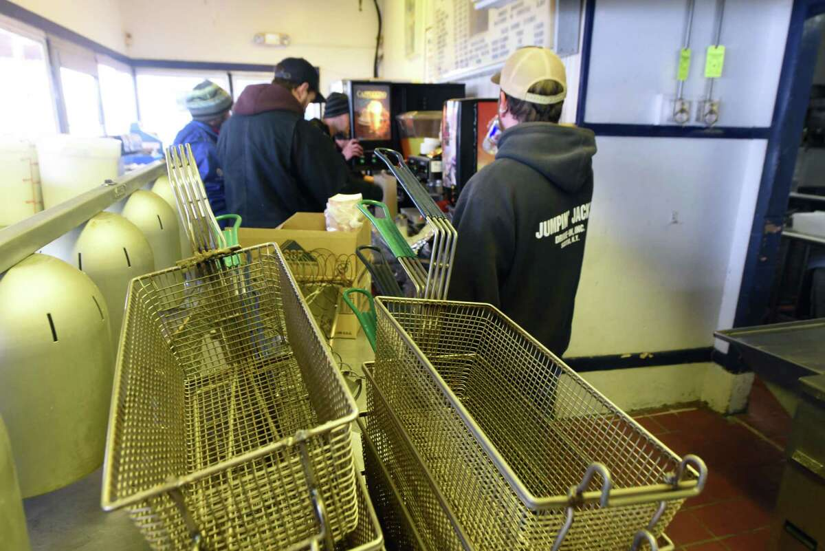 Staff members prepare the kitchen for a new season at Jumpin?' Jack?'s Drive-In on Monday, March 27, 2017, in Scotia, N.Y. The popular eatery is scheduled to open on Thursday. (Will Waldron/Times Union)