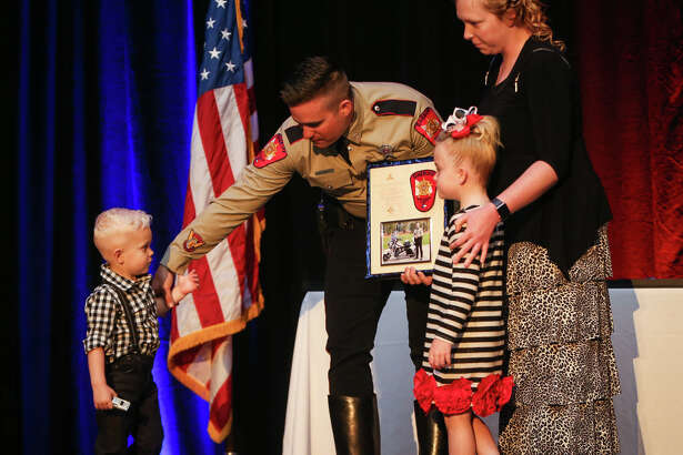 Montgomery County Sheriff's Deputy Jonathan Combs receives a Meritorious Unit Award presented by his family during The Woodlands Township Public Safety Awards Ceremony on Saturday, March 25, 2017, at The Woodlands Resort and Conference Center.
