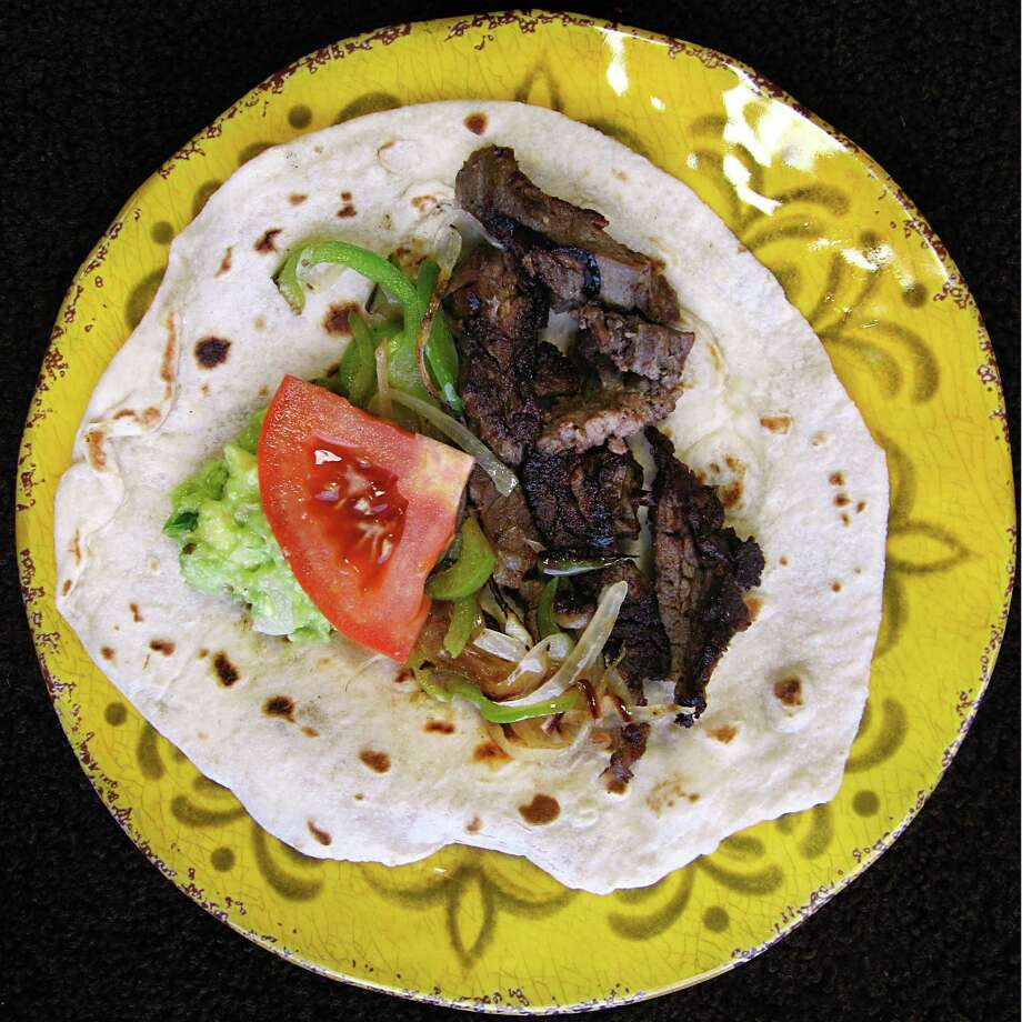 Beef fajita taco on a handmade flour tortilla from Camila's Mexican Restaurant on Henderson Pass. Photo: Mike Sutter /San Antonio Express-News