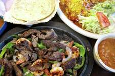 The No. 21 platter at Camila's Mexican Restaurant includes beef fajitas, shrimp, grilled peppers and onions, handmade tortillas, rice, charro beans, guacamole salad and cheese enchiladas.