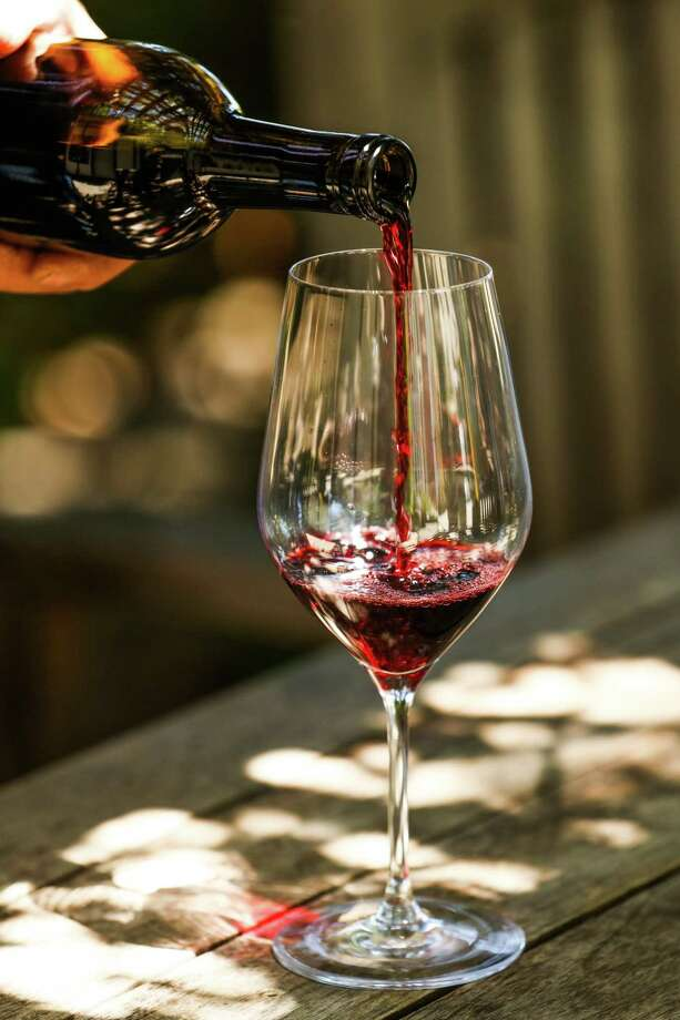 Winemaker Barry Grushkowitz pours wine into a glass at Hopper Creek winery in Napa, California, on Friday, July 29, 2016. Photo: Gabrielle Lurie, Freelance / ONLINE_YES