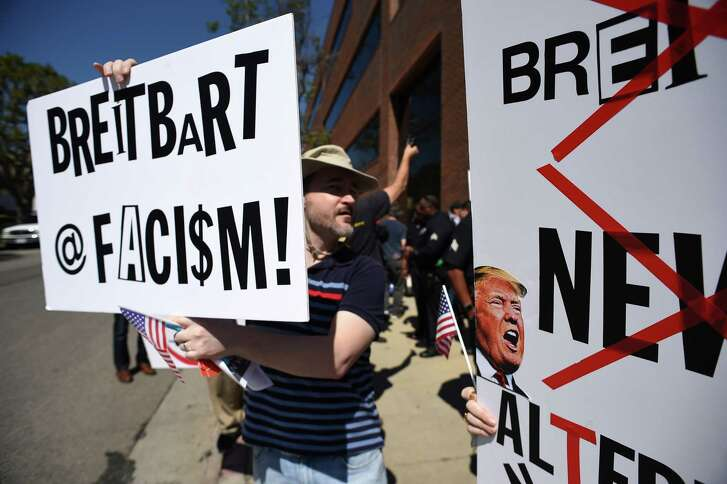 Protesters gather outside what they say are offices of Breitbart News, formerly run by Trump strategist Stephen Bannon.