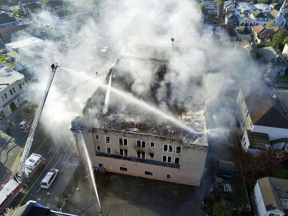 Firefighters work to put out a residential structure fire at the intersection of 26th Avenue and San Pablo in Oakland Calif. on Monday March 27, 2017. Photo: Jim Stone, Special To The Chronicle