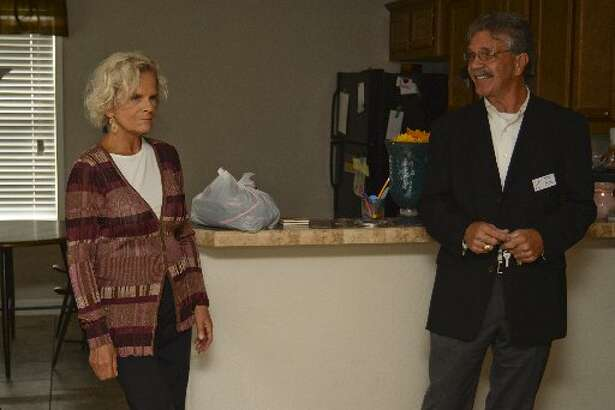 Karen Olsen, founder of Family Promise, gets a tour of one of the residences by Tom Miller, executive director, in October 2015. The nonprofit is one of three that will make a pitch tonight to 100+ Women Who Rock the Permian Basin.