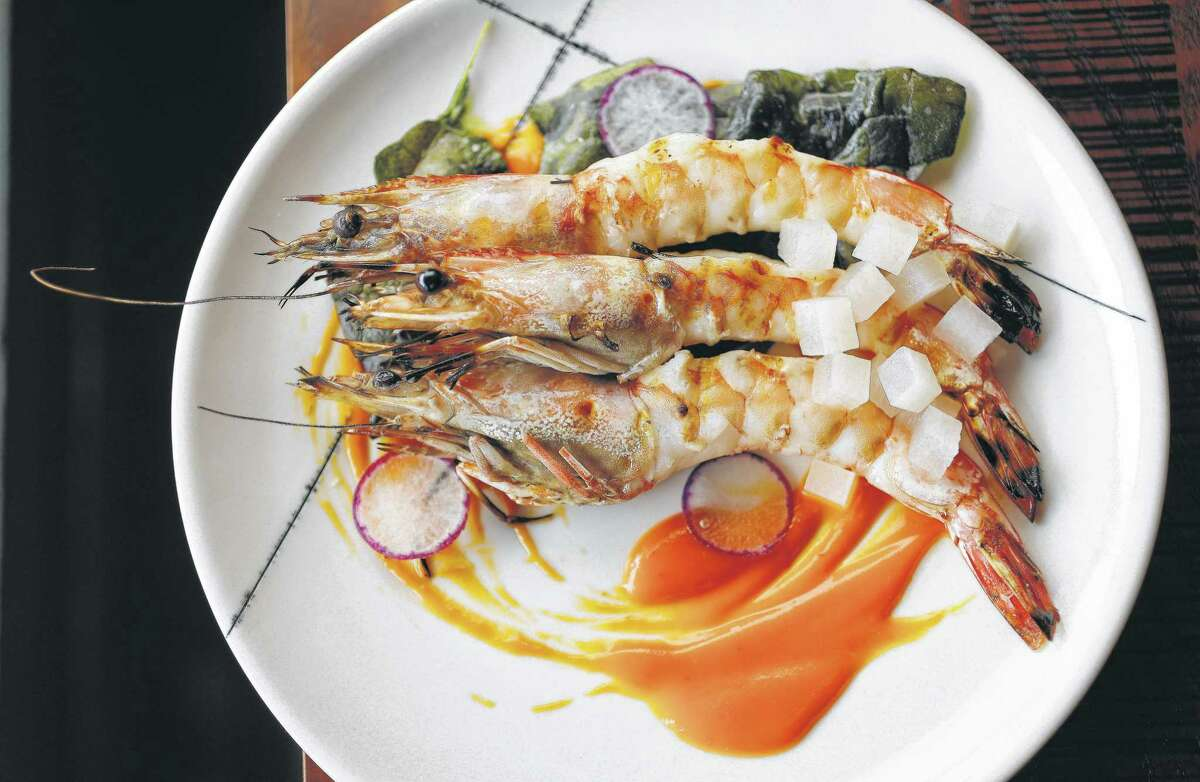 At Riel, instead of the ubiquitous shrimp and grits, prized Gulf shellfish come head-on in a scintillating hot-and-sour sauce and are served with collard greens.