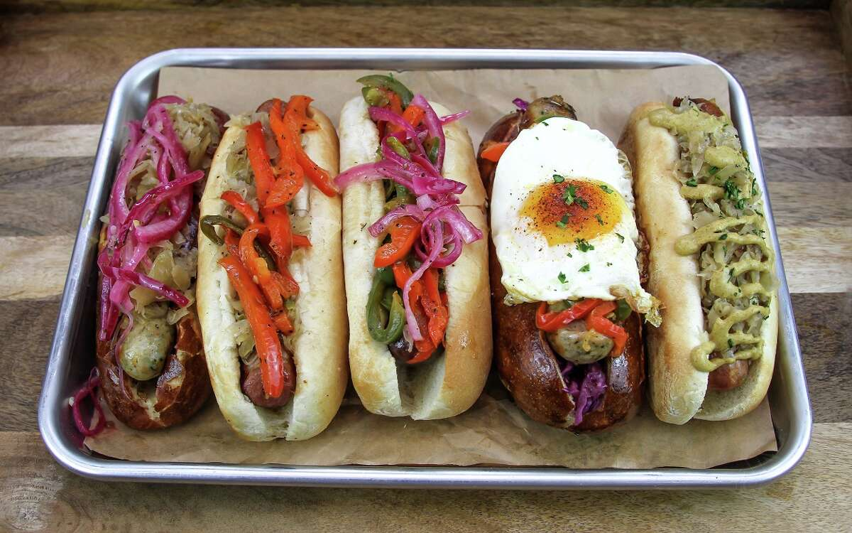Houston restaurants including King's Biergarten in Pearland and King's BierHaus in Houston are offering promotions, matching funds, and holding fundraisers to aid in Hurricane Harvey relief efforts. Shown: A variety of sausages from King's Bierhaus.