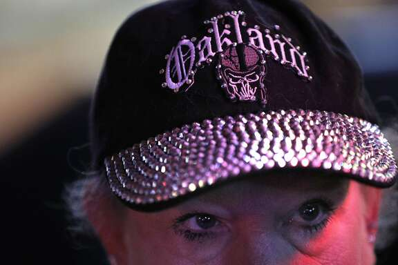 Nancy Dowell, of San Leandro, wears her Oakland Raiders hat during the announcement that the Raiders will be moving to Las Vegas at Ricky's Sports Theater and Grill in San Leandro, Calif., on Monday, March 27, 2017. The NFL announced that team owners had approved the Raiders' move to Las Vegas.