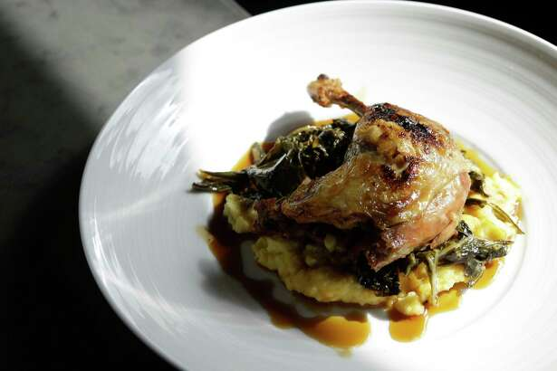 Field & Tides in the Heights serves entrees including duck confit leg.