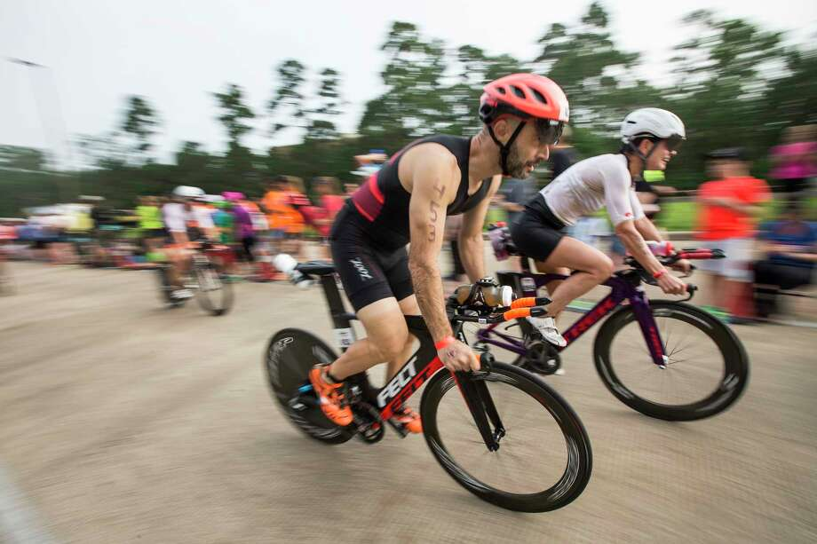 Continue clicking to see photos of past Ironman competitors in the Houston area. Photo: Brett Coomer, Staff / © 2016 Houston Chronicle