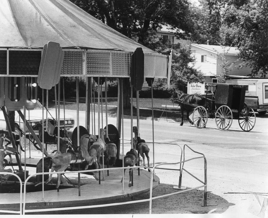 An Amish buggy is parked on a street near the carousel at the midway, July 1982 Photo: Daily News File Photo