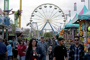 People meander around the carnival during the San Antonio Stock Show & Rodeo Feb. 26, 2017.