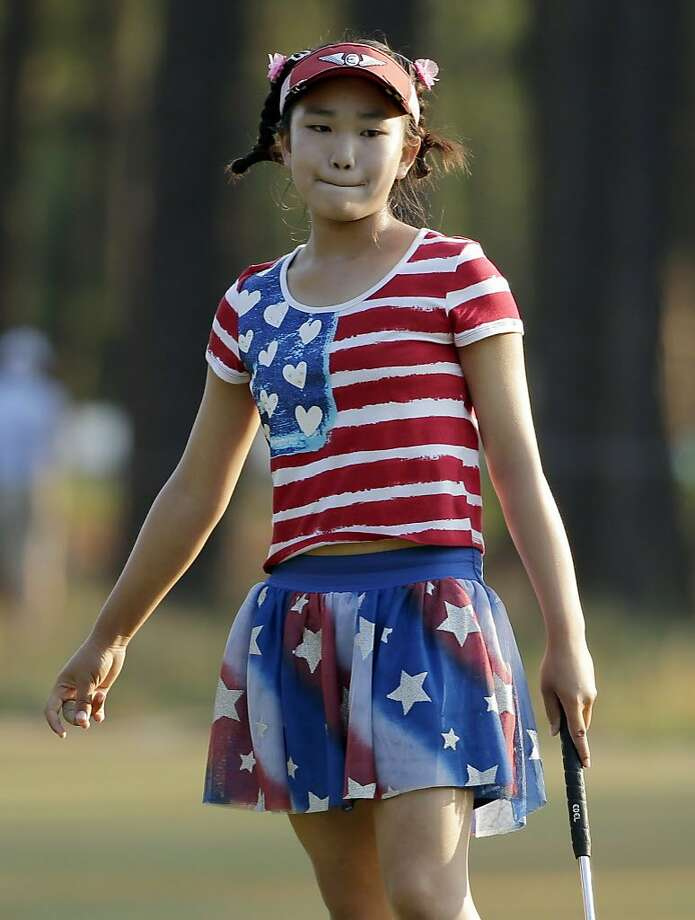 Lucy Li reacts to her putt on the 11th hole during the first round of the U.S. Women's Open golf tournament in Pinehurst, N.C., Thursday, June 19, 2014. (AP Photo/Chuck Burton) Photo: Chuck Burton / Associated Press
