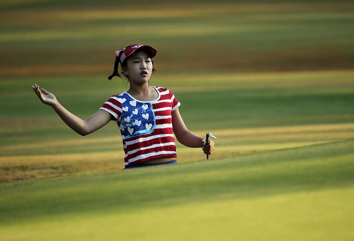 Lucy Li reacts to her shot on the 10th hole during the first round of the U.S. Women's Open golf tournament in Pinehurst, N.C., Thursday, June 19, 2014. (AP Photo/Chuck Burton)