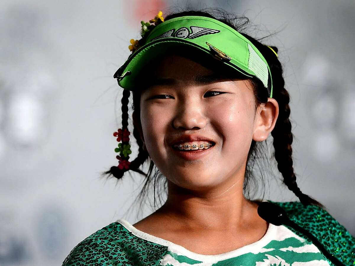Lucy Li, 11, answers questions from the media during a press conference for the U.S. Women's Open Championship at Pinehurst No. 2 on Tuesday, June 17, 2014 in Pinehurst, N.C. (Jeff Siner/Charlotte ObserverMCT)