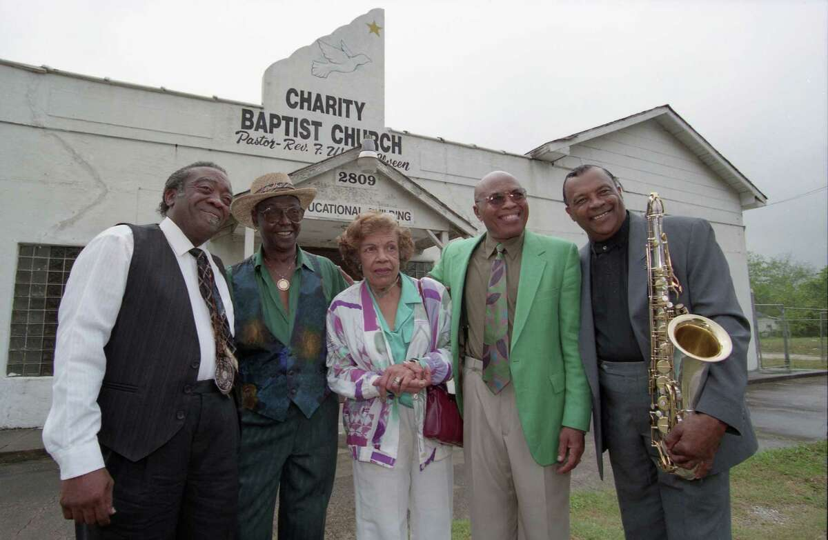 """Joe """"Guitar"""" Hughes, left, Johnny Brown, Evelyn Johnson, Milton Hopkins and Grady Gaines reunite in front of the former home of the legendary Duke/Peacock Records in the Fifth Ward in this 1996 photo."""