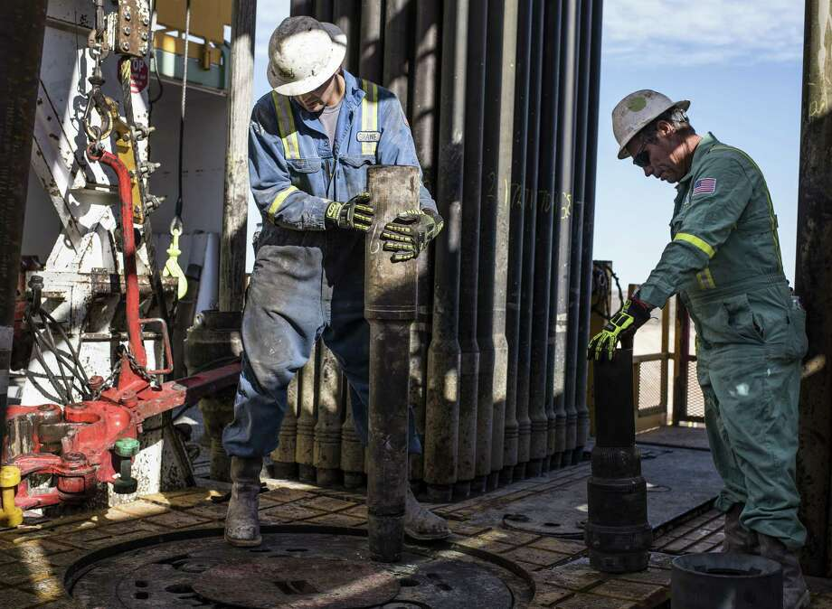 Precision Drilling oil rig operators install a bit guide on the floor of a Royal Dutch Shell Plc oil rig near Mentone, Texas, U.S., on Thursday, March 2, 2017. Exxon Mobil Corp., Royal Dutch Shell and Chevron Corp., are jumping into American shale with gusto, planning to spend a combined $10 billion this year, up from next to nothing only a few years ago. Photographer: Matthew Busch/Bloomberg Photo: Matthew Busch / © 2017 Bloomberg Finance LP