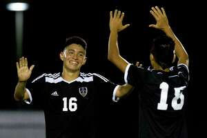 Conroe midfielder Ricardo Aguilera (16) celebrates with midfielder Josafat Hernandez (18) after the Tigers' tied College Park 1-1 to secure the fourth playoff spot from District 12-6A after a high school boys soccer match at College Park High School Friday, March 17, 2017, in The Woodlands.