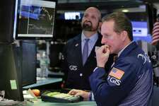 Specialists Glenn Carell, right, and James Denaro work on the floor of the New York Stock Exchange, Monday, March 27, 2017. Banks and industrial companies are leading stocks lower on Wall Street in early trading. (AP Photo/Richard Drew) ORG XMIT: NYRD101