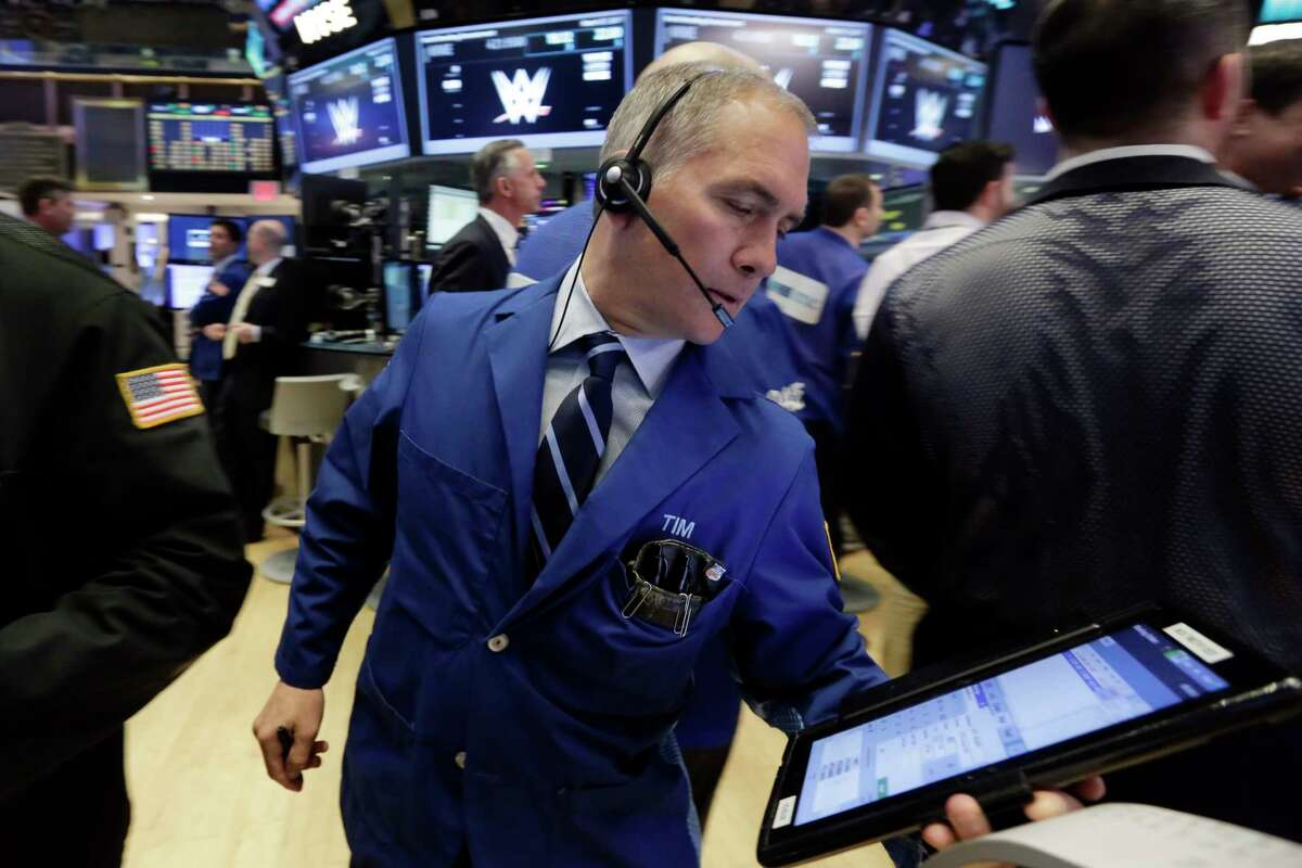 Trader Timothy Nick works on the floor of the New York Stock Exchange, Monday, March 27, 2017. Banks and industrial companies are leading stocks lower on Wall Street in early trading. (AP Photo/Richard Drew) ORG XMIT: NYRD102