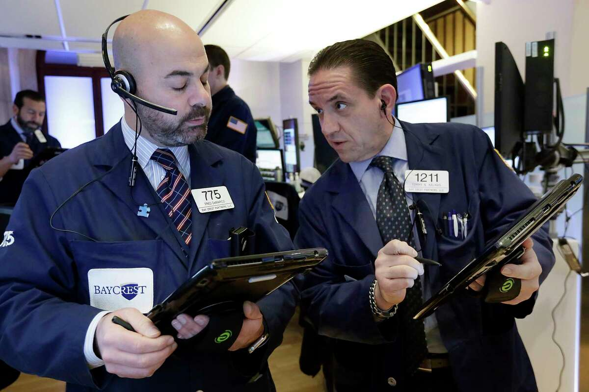 Traders Fred Demarco, left, and Tommy Kalikas work on the floor of the New York Stock Exchange, Monday, March 27, 2017. Banks and industrial companies are leading stocks lower on Wall Street in early trading. (AP Photo/Richard Drew) ORG XMIT: NYRD103