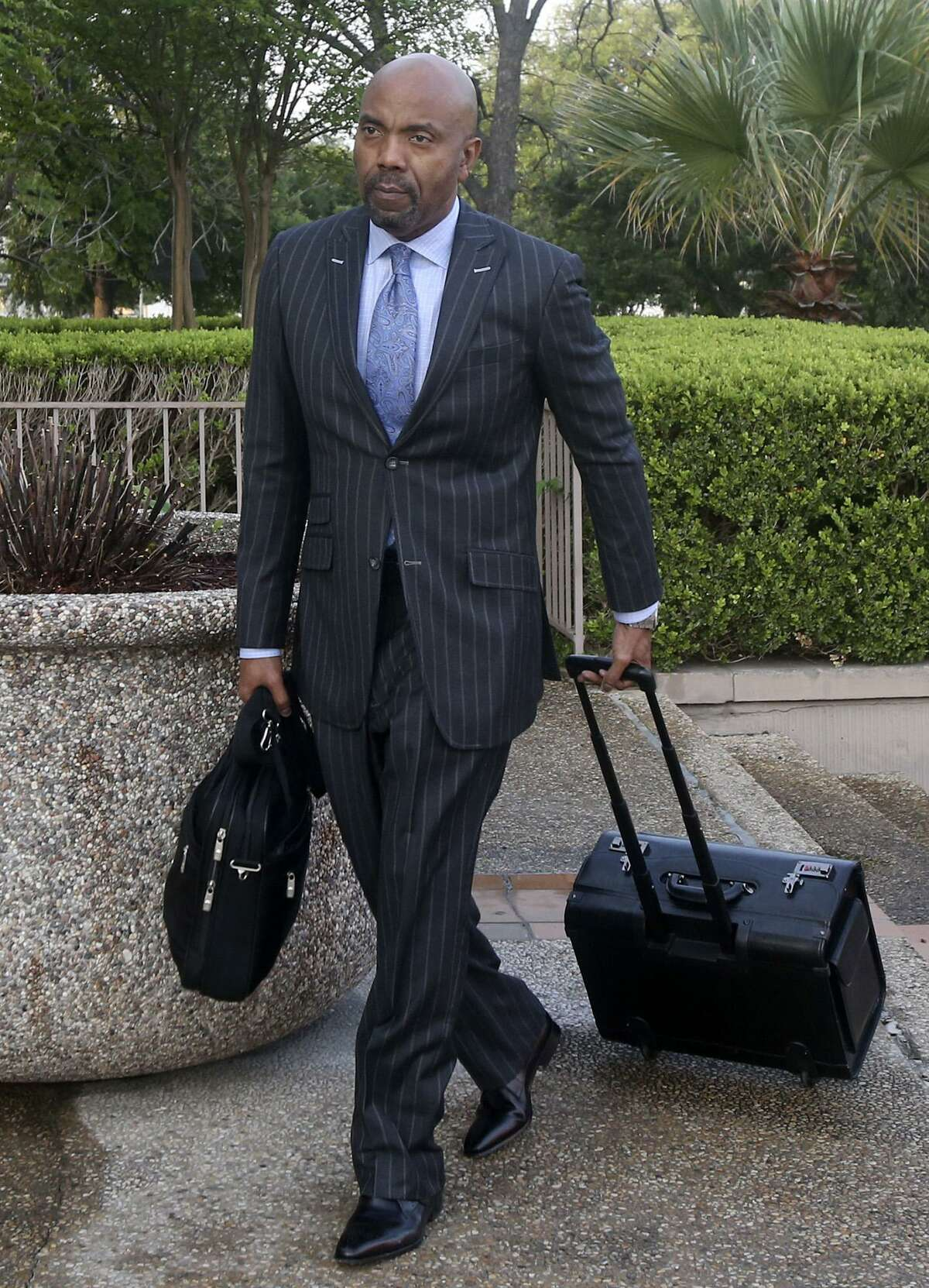 Attorney Daryl Washington walks toward the John H. Wood Federal Courthouse on March 27, 2017. Washington represents the family of Marquise Jones, who was fatally shot by San Antonio police officer Robert Encina in 2014.
