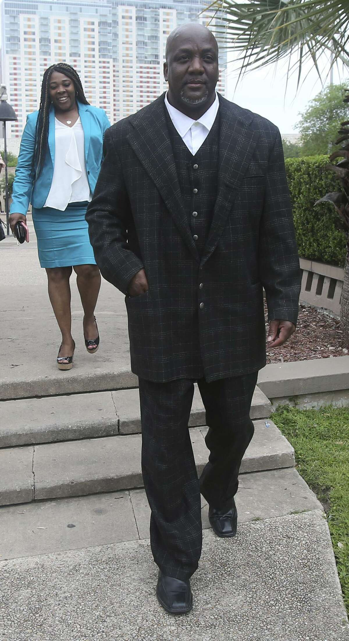 Blake Lamkin, the father of Marquise Jones, walks from the John H. Wood Federal Courthouse.