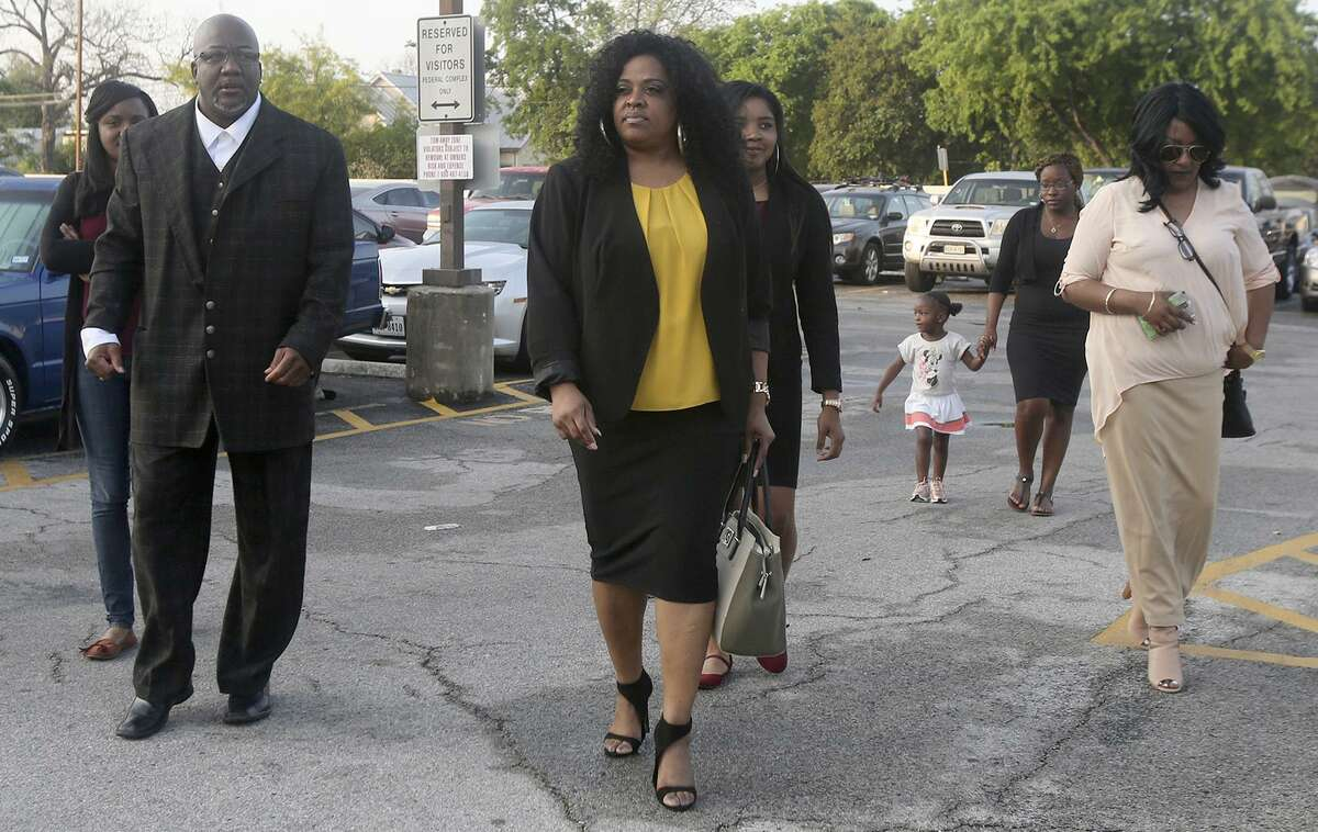 Blake Lamkin (left), father of Marquise Jones, walks with family and friends toward the John H. Wood Federal Courthouse on March 27, 2017. Marquise Jones was fatally shot by San Antonio police officer Robert Encina in 2014. Jones' family is suing Encina and the city, basing the suit on the claim that the shooting was an unjustified use of force.