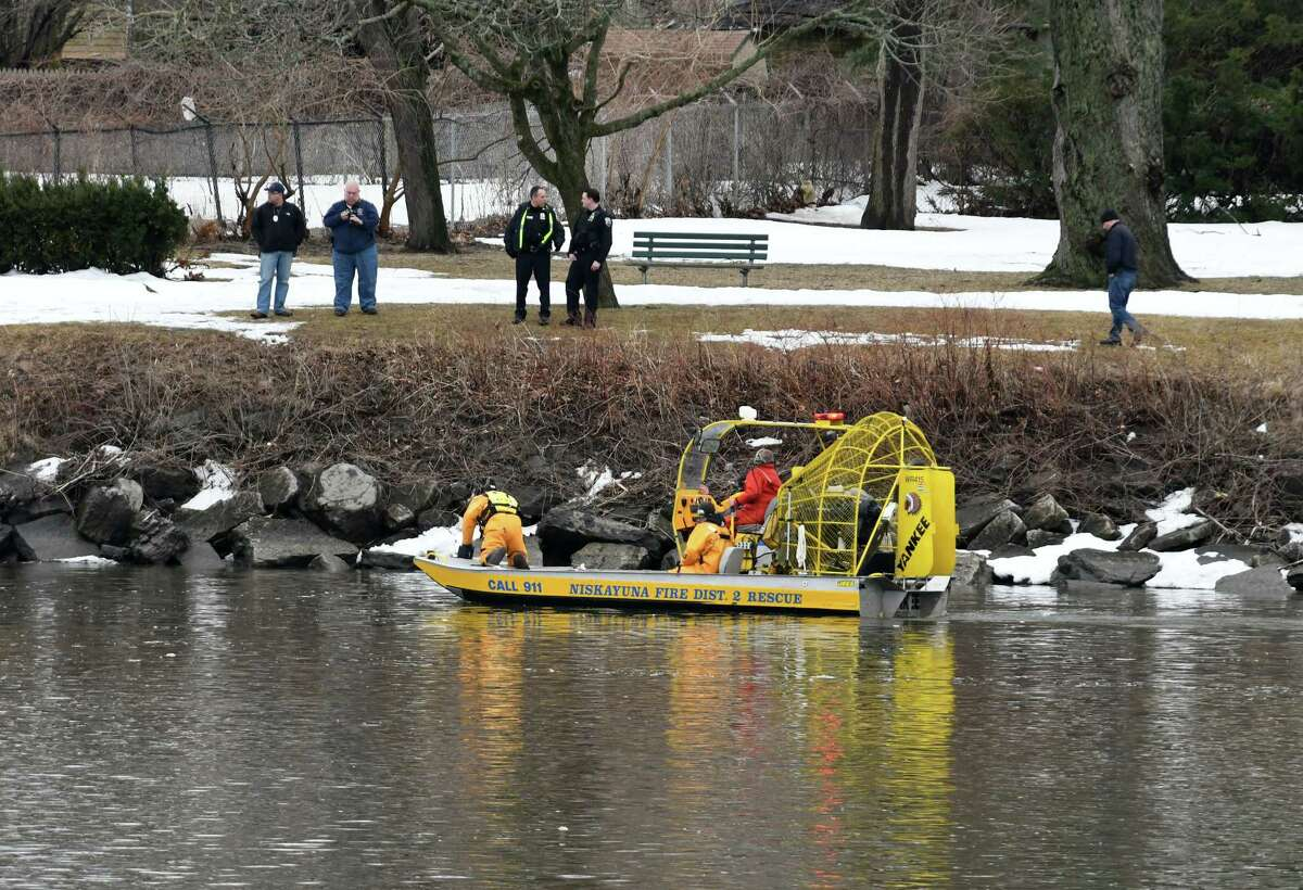 Safety personnel search the Mohawk River for a person who was reported to have fallen in on Monday, March 27, 2017, in the Stockade neighborhood of Schenectady, N.Y. (Will Waldron/Times Union)