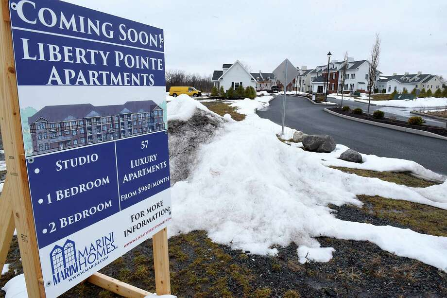 A sign for Liberty Pointe Apartments is seen near the entrance of the Village at Shaker Creek luxury gated residences located behind Village at New Loudon on Monday, March 27, 2017 in Latham, N.Y. ( Lori Van Buren / Times Union) Photo: Lori Van Buren / 20040067A