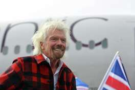 Virgin founder Sir Richard Branson arrives on a Boeing 787-9 for an event announcing Virgin Atlantic's new non-stop daily Seattle to London flights, Monday, March 27, 2017.