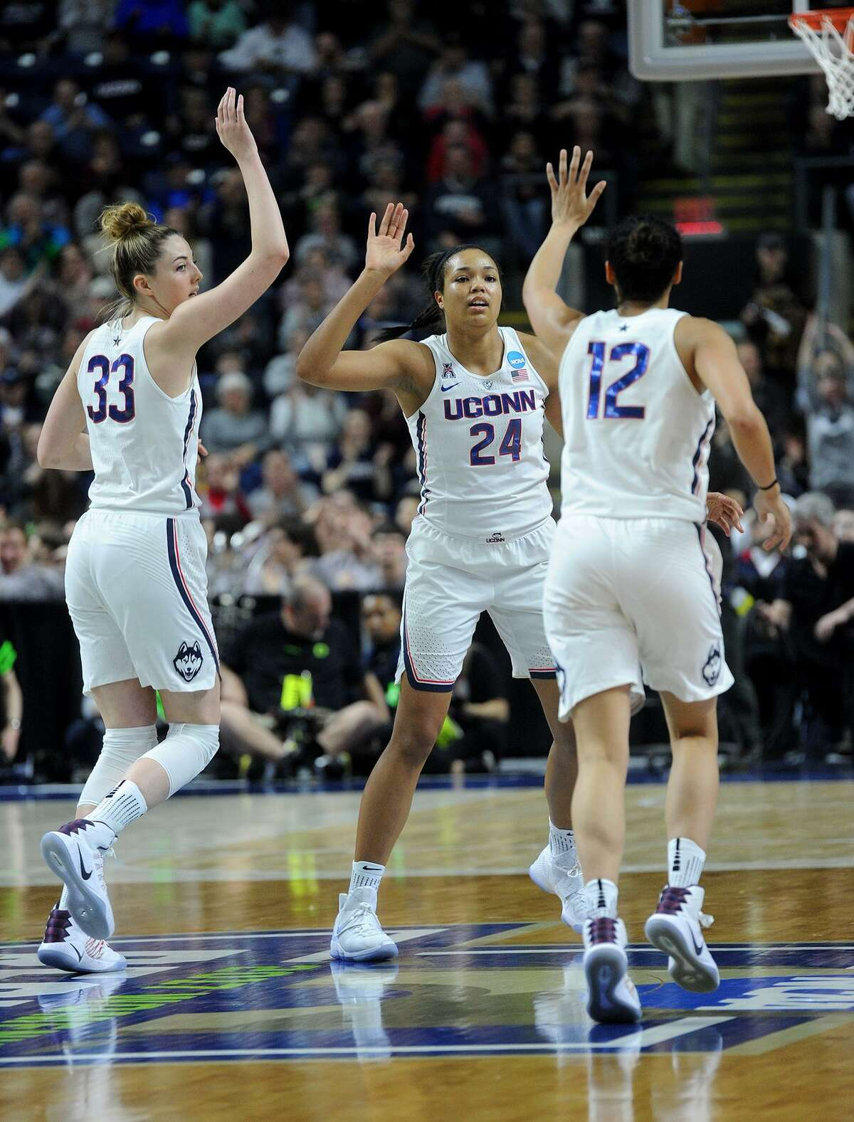From left; UCONN players Katie Lou Samuelson, Napheesa Collier, and Saniya Chong celebrate a made basket during the first half of the NCAA Women's Basketball Regional Final game with Oregon at the Webster Bank Arena in Bridgeport, Conn. on Monday, March 27, 2017.