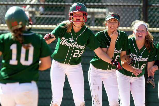 The Woodlands players cheer as Kelcy Leach comes in after hitting a two-run home run off Liberty pitcher Sarah Lopez during the third inning of a high school softball game at The Woodlands Varsity Round Robin Invitational at The Woodlands High School Friday, Feb. 24, 2017, in The Woodlands.
