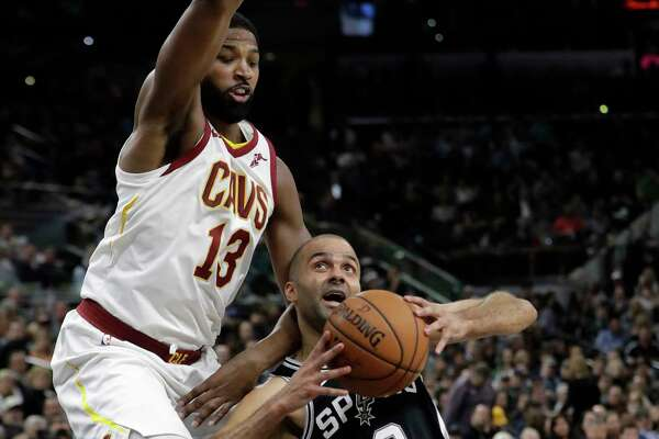 San Antonio Spurs forward Kawhi Leonard (2) celebrates a basket with Spurs' LaMarcus Aldridge, right, and Patty Mills, of Australia, during the first half of an NBA basketball game against the Cleveland Cavaliers, Monday, March 27, 2017, in San Antonio. (AP Photo/Darren Abate)