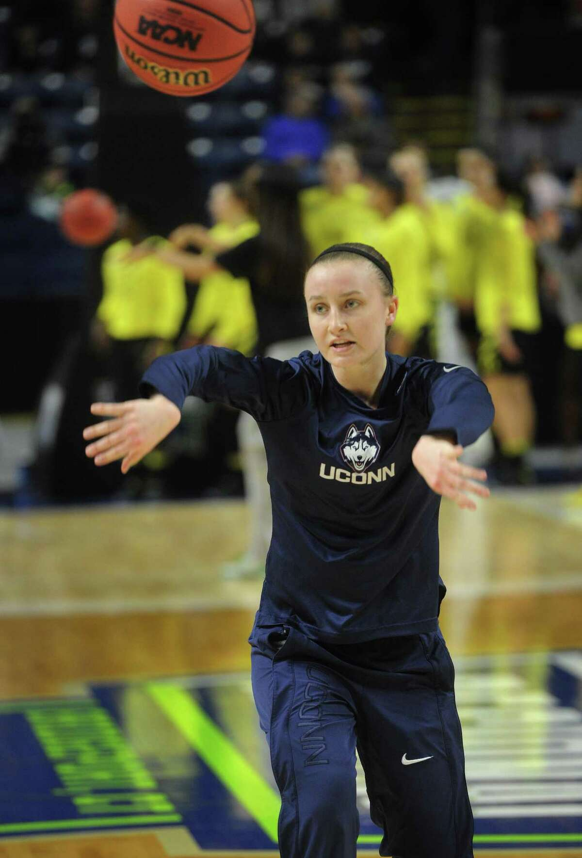 UConn's Tierney Lawlor, of Ansonia, warms up before Monday night's game in Bridgeport.