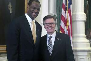 Spurs baskeball legend David Robinson, left, poses with Lt. Gov. Dan Patrick as he visits the Capitol Monday, March 27, 2017. Robinson was in Austin advocating to allow the use of public money for private schools.